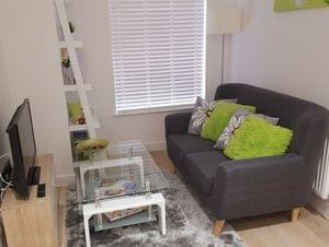MOVING OUT SALE: Stylish grey sofa 2 seater